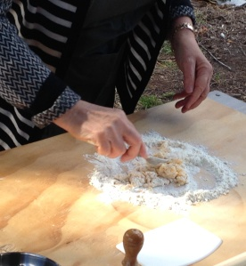 Hilda mixes the eggs and flour together to make pasta